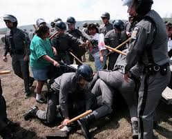 New York State Troopers attack women, children, babies, men at Onondaga on May 18, 1997.