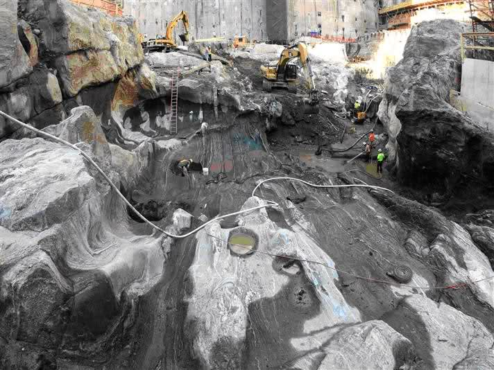 Huge caverns of melted granite below Twin Tower foundations caused by thermo nuclear explosions that obliterated the steel cased concrete core structure of #1 and #2.