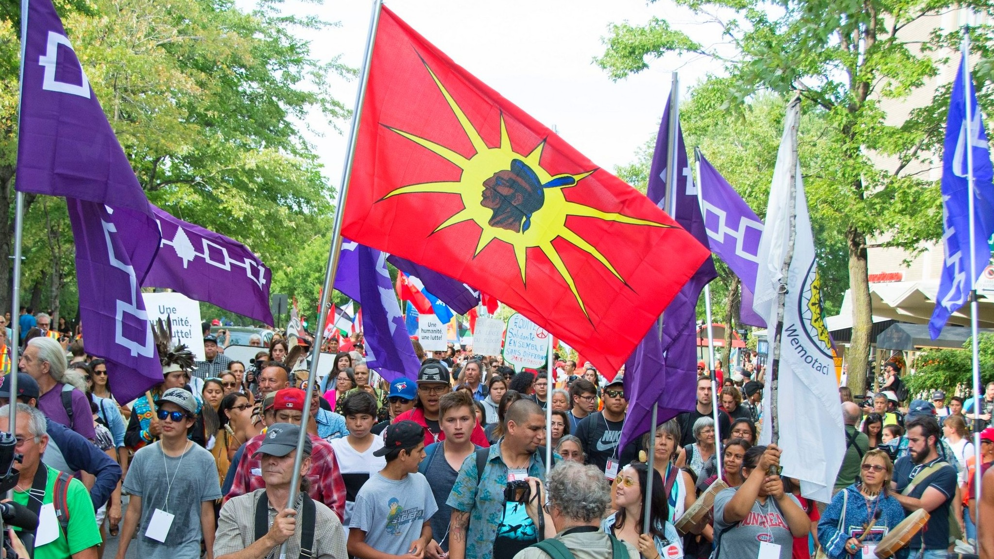 mother earth's children lead the march of over 10,000 people in search of world peace.